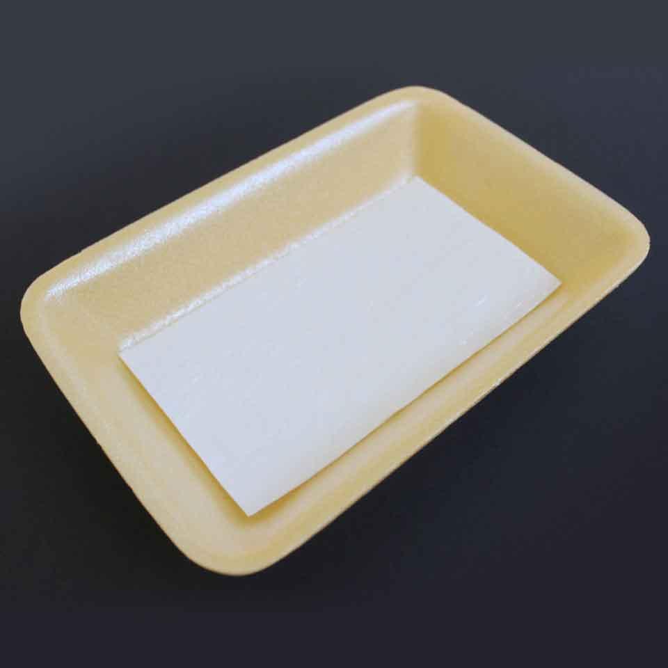 Absorvente (Alimentos) - 50mL Premium - Aspecto em embalagem amarela.