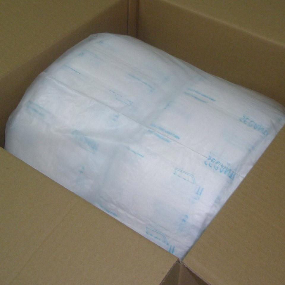 Duas bobinas protegidas por Saco Plástico dentro de Caixa de Papelão
